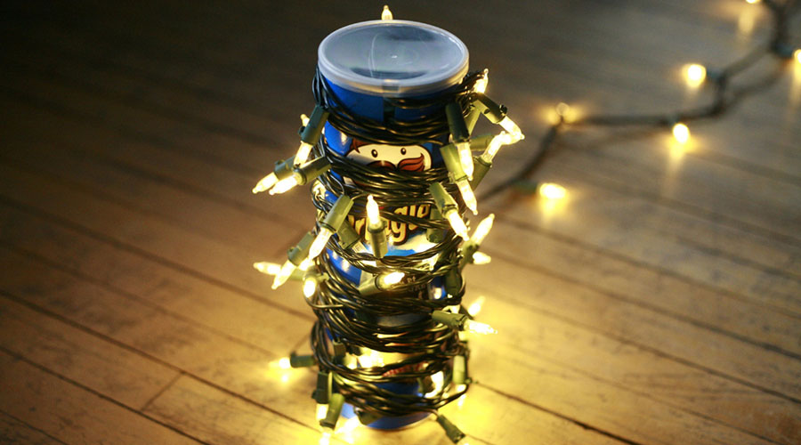 Christmas lights wrapped around a Pringles can.