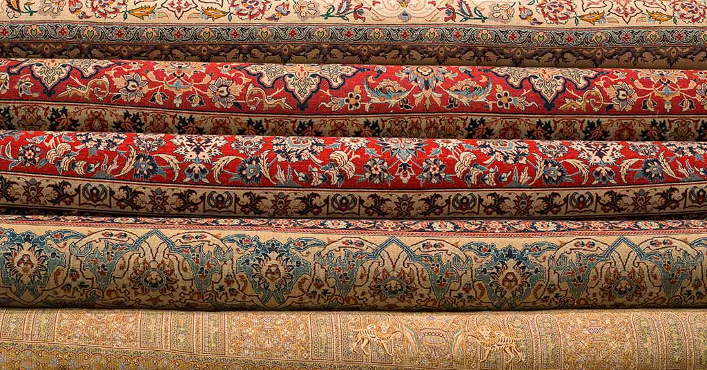 Rolled Up Persian Or Turkish Carpets And Rugs