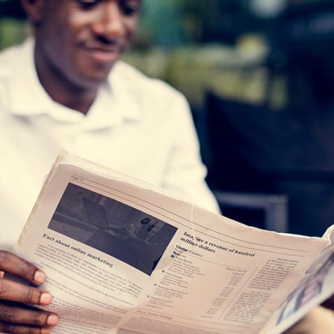 man newspaper The Witness
