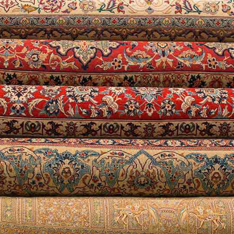rolled up Turkish oriental carpets and rugs