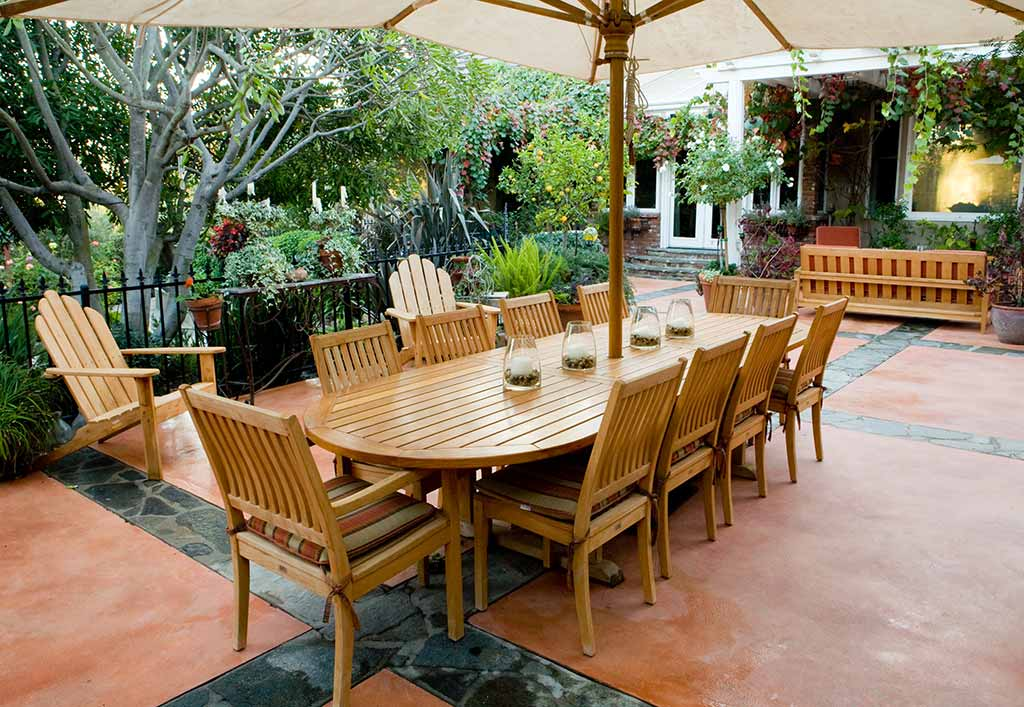 wooden outdoor dining set and umbrella